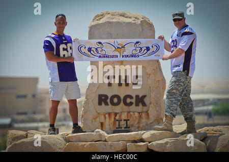 In anticipation of the upcoming NFL regular season kickoff, Minnesota Vikings fans and deployed U.S. soldiers Chief - Stock Photo