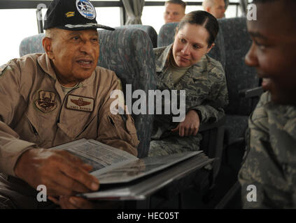 JOINT BASE BALAD, Iraq – Retired Lt. Col. James Warren, an Original Tuskegee Airman, shares his scrapbook with Staff - Stock Photo