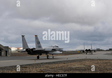 KEFLAVIK, Iceland -- Two F-15C Eagles deployed from Royal Air Force Lakenheath taxi at Keflavik International Airport, - Stock Photo