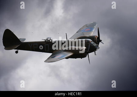 A Bristol Blenheim light bomber breaks through the clouds above RAF Fairford, United Kingdom, during the Royal International - Stock Photo