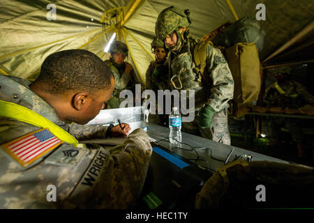 U.S. Army Staff Sgt. Jason Wright, left, a transportation movement coordinator with Headquarters and Headquarters - Stock Photo