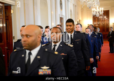 Members of the U.S. Air Force Academy football team march into the East Room of the White House, for the presentation - Stock Photo