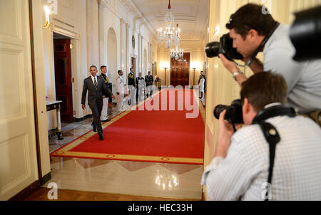 President Barack Obama walks toward the East Room of the White House or the presentation of the Commander-in-Chief - Stock Photo