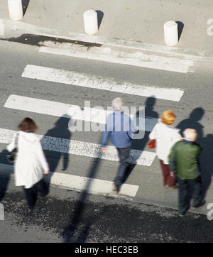 People crossing the street on a zebra - Stock Photo