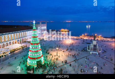Christmas tree on Commerce square at twilight in Lisbon, Portugal - Stock Photo