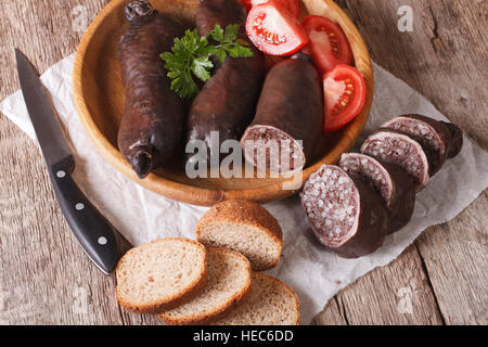 Delicious blood sausages and vegetables on a table close-up. horizontal - Stock Photo