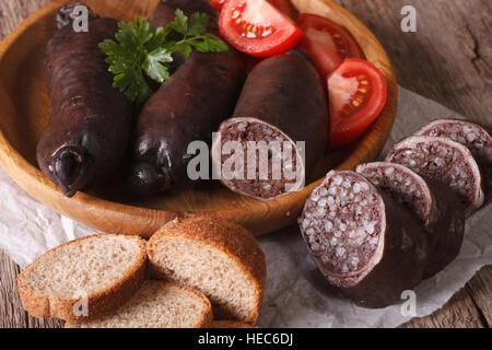 Fresh blood sausages and vegetables on a table close-up. horizontal - Stock Photo