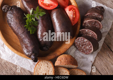 blood sausage with tomato on a plate close-up. horizontal view from above - Stock Photo