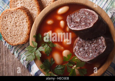 Spanish FABADA ASTURIANA soup with black pudding close up on the table. horizontal view from above - Stock Photo