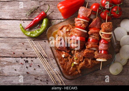 Preparing food for cooking barbecue on skewers. horizontal view from above, rustic - Stock Photo