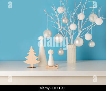 Vase In White Knitted Cover With White Branches And Christmas Toys