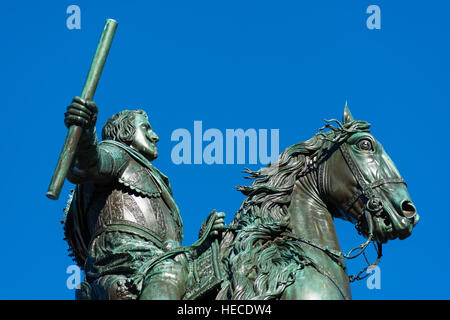 Madrid, Spain. Plaza de Oriente with Palacio Real, or Royal Palace background. Equestrian statue of Philip IV by - Stock Photo