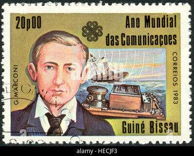 A stamp printed in Guinea-Bissau, shows an Italian inventor and engineer Guglielmo Marconi, 1st Marquis of Marconi - Stock Photo