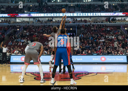 Chicago, USA.  19 December 2016. Tip-off at the Chicago Bulls vs Detroit Pistons game at the United Center in Chicago. - Stock Photo