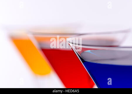 Colorful Cocktails in Martini Glasses Background. Bar Commercials Concept. - Stock Photo