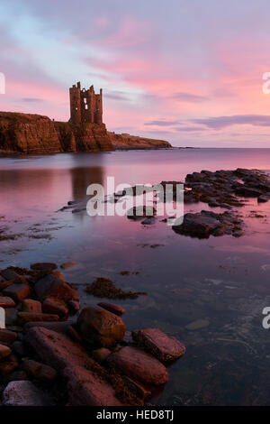 Keiss Castle, Cathness, Scotland at sunrise - Stock Photo