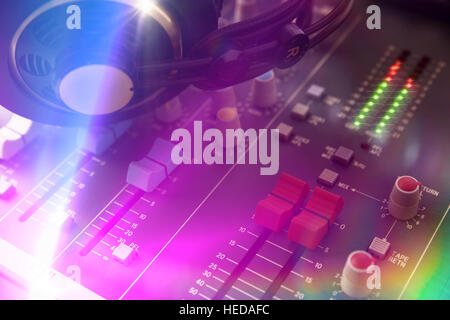 Close up headphones on dj sound mixer. Top elevated view. Horizontal composition - Stock Photo