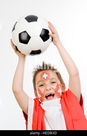 Seven-year-old boy holding a football, Swiss soccer fan - Stock Photo