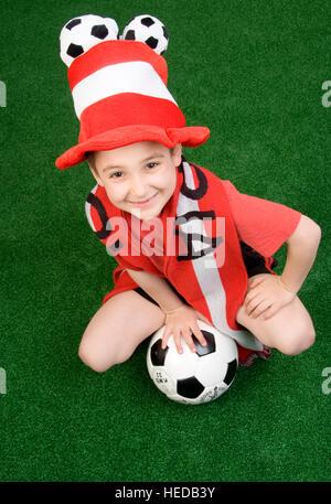 7-year-old boy, Austrian soccer fan, football supporter - Stock Photo