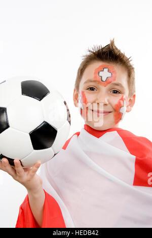 7-year-old boy, Swiss soccer fan, football supporter - Stock Photo
