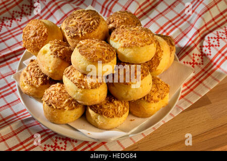 Group of fresh traditional hungarian country food - baked cheese cakes - 'pogácsa' on a plate - Stock Photo