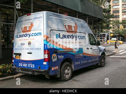 An eLaundry van park in the street in Manhattan. - Stock Photo