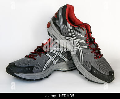 A pair of brand new Asics running shoes isolated on white. - Stock Photo