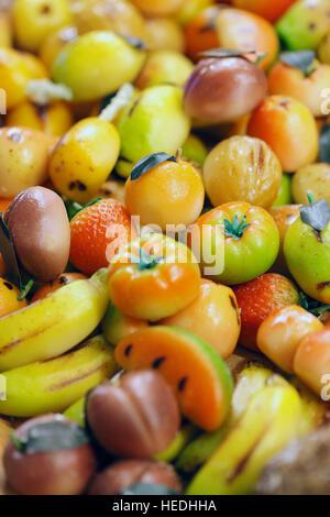 Marzipan cakes close up on Christmas market - Stock Photo