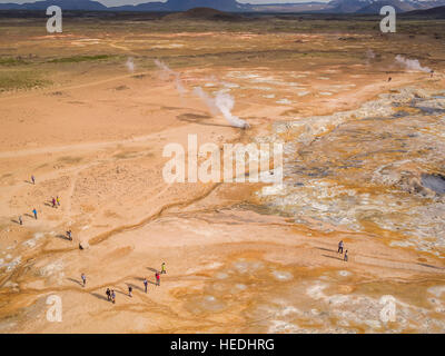 Tourists at Namaskard Geothermal area in Northern Iceland. Drone photography - Stock Photo