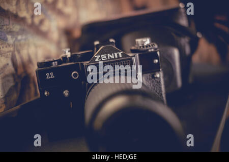 An old Russian  ZENIT 35mm analogue film SLR camera on sale at Coastal Vintage, retro and vintage clothes shop, - Stock Photo