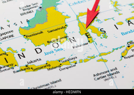 Red arrow pointing Indonesia on the map of Asia continent - Stock Photo
