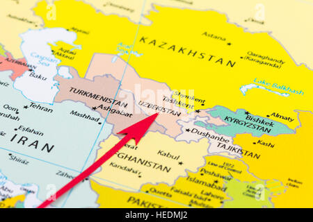Red arrow pointing Uzbekistan on the map of Asia continent - Stock Photo