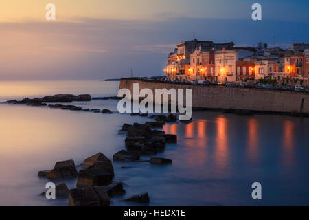 Seafront of Ortygia at dawn, Syracuse, Italy. - Stock Photo