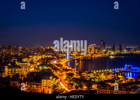 View over Baku skyline at night, Azerbaijan - Stock Photo