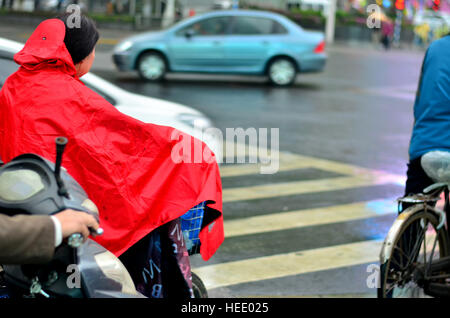 A women waiting for traffic signal to turn green - Stock Photo