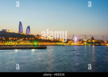 View over Baku skyline with Flame towers at night, Azerbaijan - Stock Photo