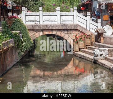Ancient bridge in Dayan old town. Lijiang, China. - Stock Photo