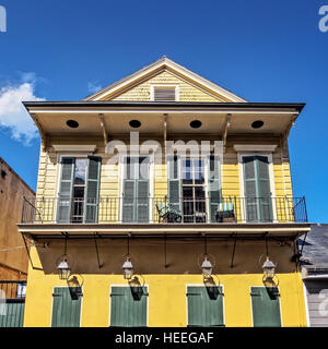 Yellow Building with Green Doors and Shutters French Quarter - Stock Photo