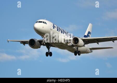 Finnair Airbus A320-200 OH-LXB landing at Heathrow Airport, London - Stock Photo
