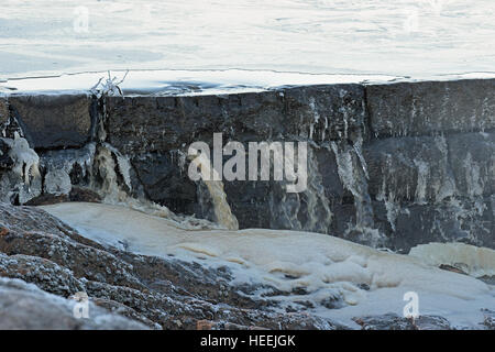 Leaking old dam on winter. - Stock Photo