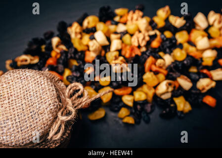 set vegetarian of dried fruit, candied fruit and nuts on a stone table - Stock Photo