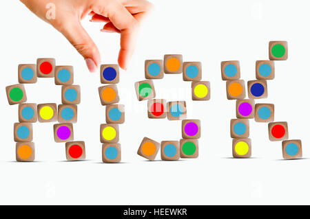 Risk concept with wooden pieces of a game forming the word Risk - Stock Photo