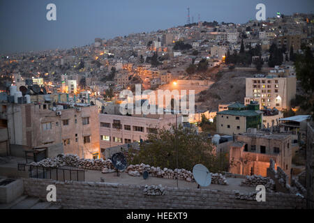 Nighttime street scene in Amman, Jordan showing the ancient Roman amphitheater. - Stock Photo