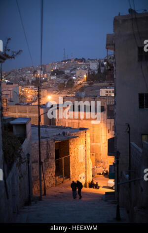 Nighttime street scene in Amman, Jordan near the ancient Roman amphitheatre. - Stock Photo
