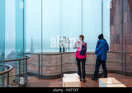 Tourists taking pictures of the artwork Saluting Admiral Couple by Guillaume Bijl at MAS / Museum aan de Stroom, - Stock Photo