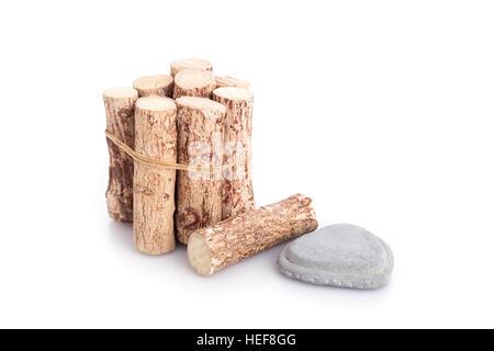 Thanaka wood and grey Kyauk Pyin stone slabs isolated on white background - Stock Photo