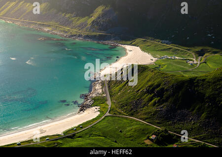 Fjord landscape with beach and road on coast in Lofoten, Norway - Stock Photo