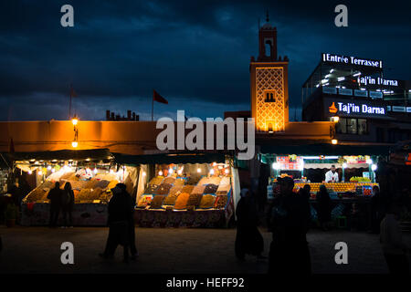 MARRAKESH, MOROCCO - DECEMBER 2016: People during the evening on the very busy main square of Marrakesh in Morocco - Stock Photo