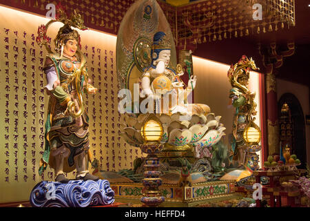 Interior of the Buddha Tooth Relic temple in Chinatown, Singapore - Stock Photo