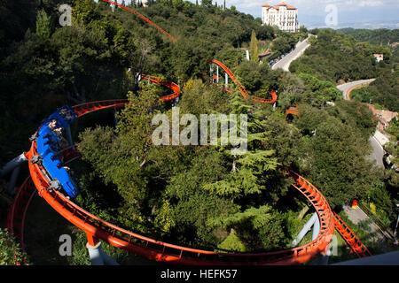 Roller coaster in The Tibidabo theme park, Barcelona, Spain. Tibidabo is a mountain overlooking Barcelona, Catalonia, - Stock Photo